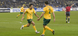 Socceroos Captain Lucas Neill with teammate during tournament