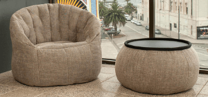 Brown creamy nude bean bag sofa chair with brown wing ottoman table overlooking Luna Park