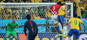 Brazil Soccer Players in yellow jersey tries to kick goal while Croatia in red jersey tries to block of the score in World Cup 2014