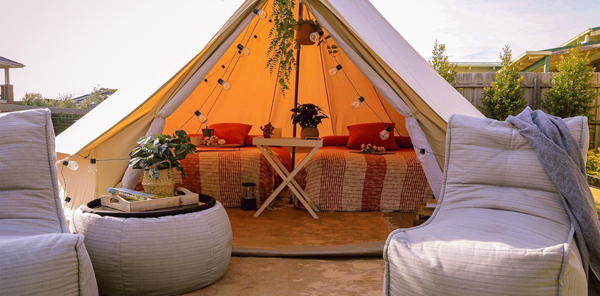 Ambient Lounge Evolution Sofas and Versa Table in Silverline in a Tipi