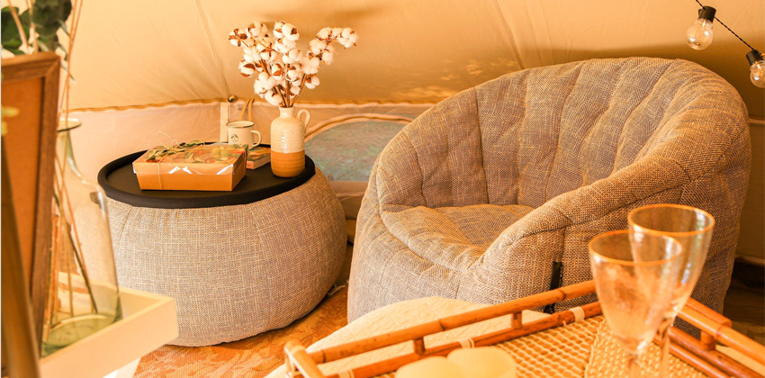 relaxing Ambient Lounge butterfly sofa and versa table in a tipi