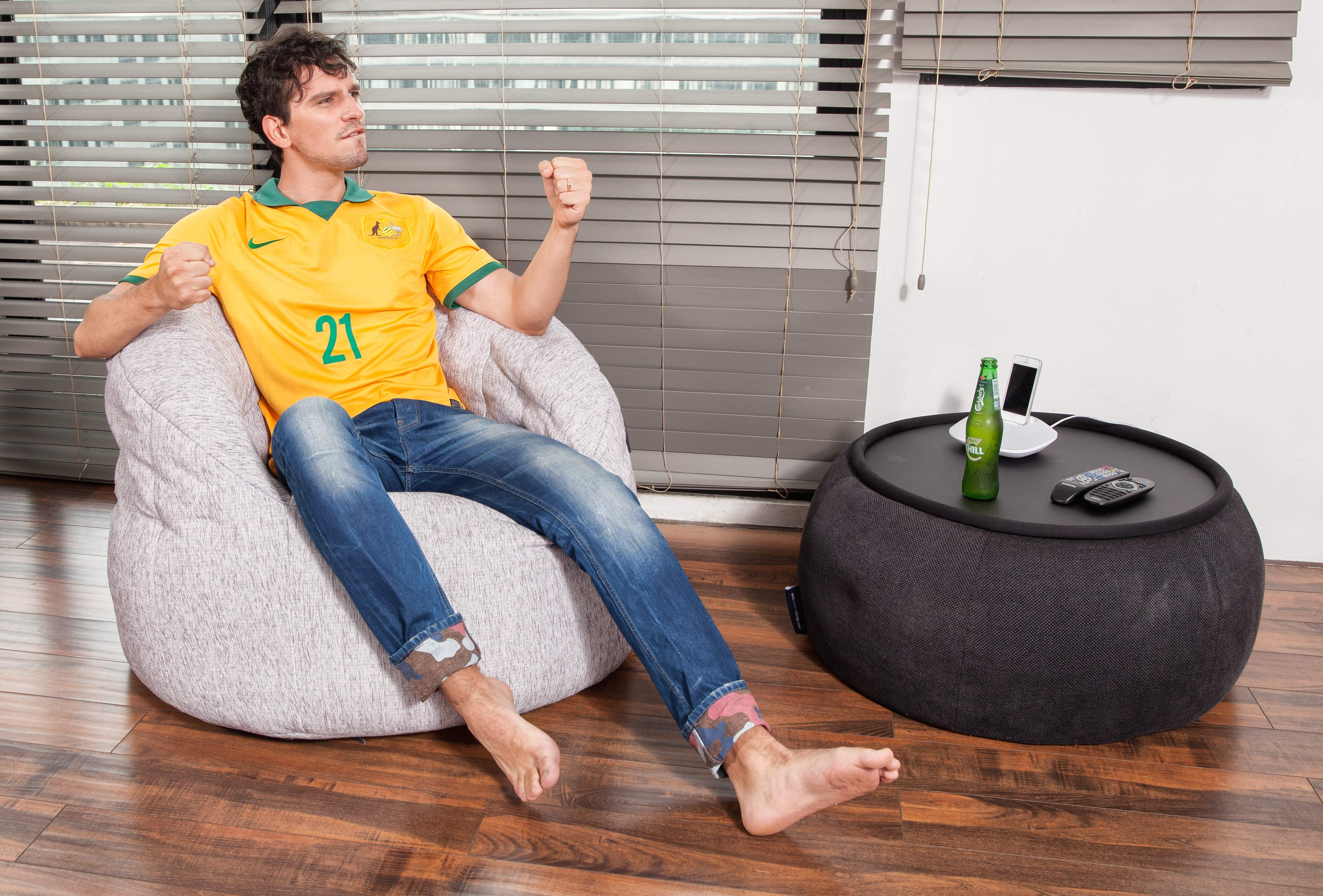 Soccers Fan Watches Australia V Netherlands Worldcup2014 On Ambient Lounge Bean Bags